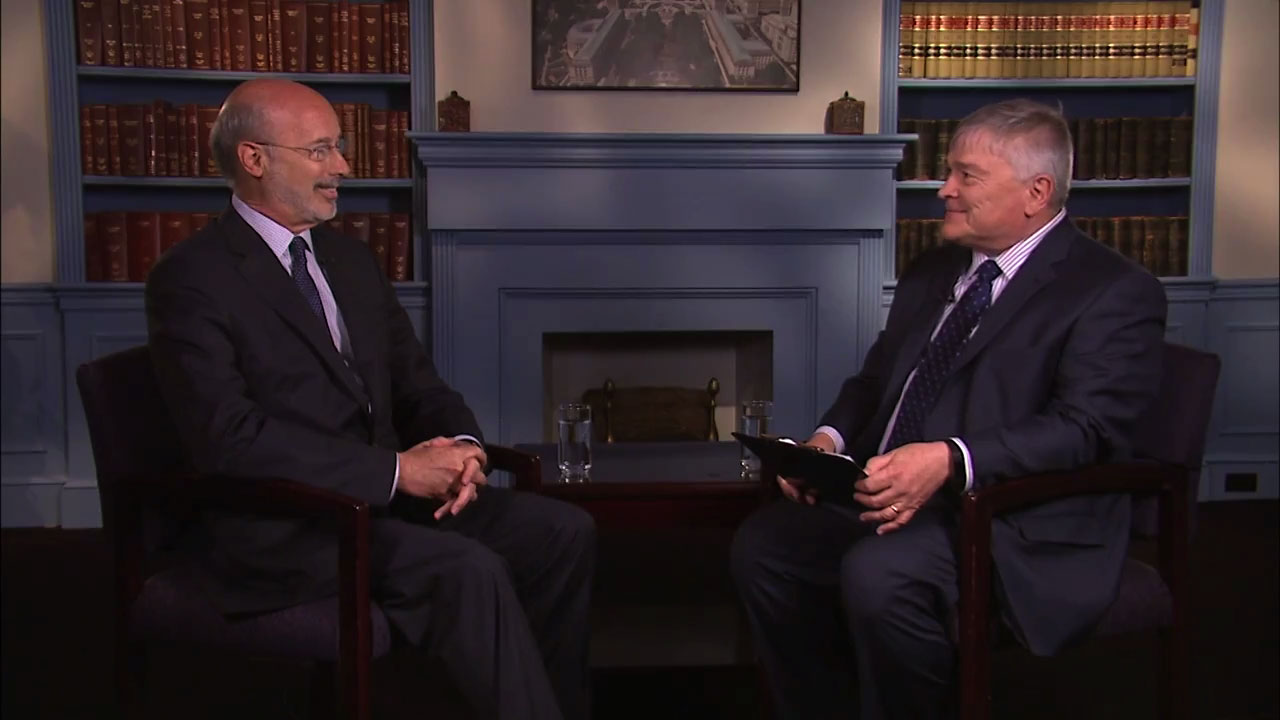 Governor Tom with speaking with Penn State President Eric Barron