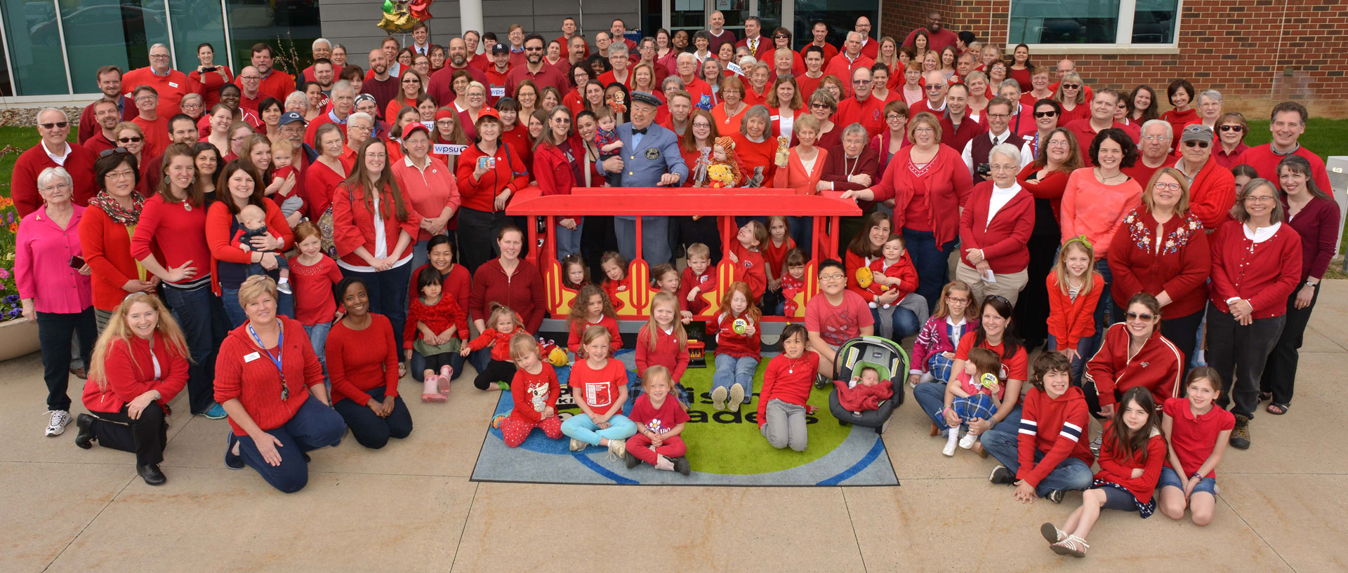 Large group of people dressed in red sweaters to support Red Sweater Day at WPSU