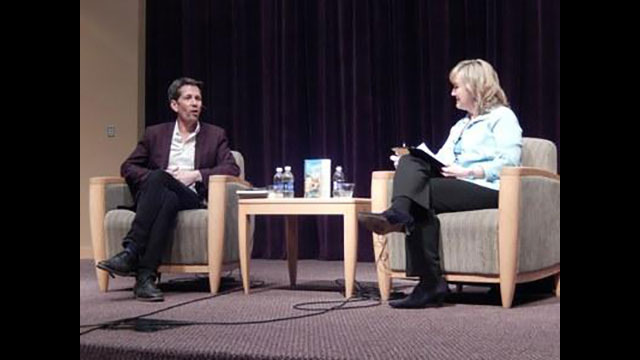 Patty Satalia talks with bestselling author Jess Walter at Penn State's HUB Robeson Center.