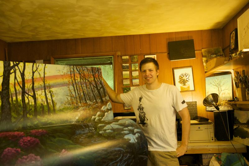 Local artist Sean Bodley stands next to his completed bench.