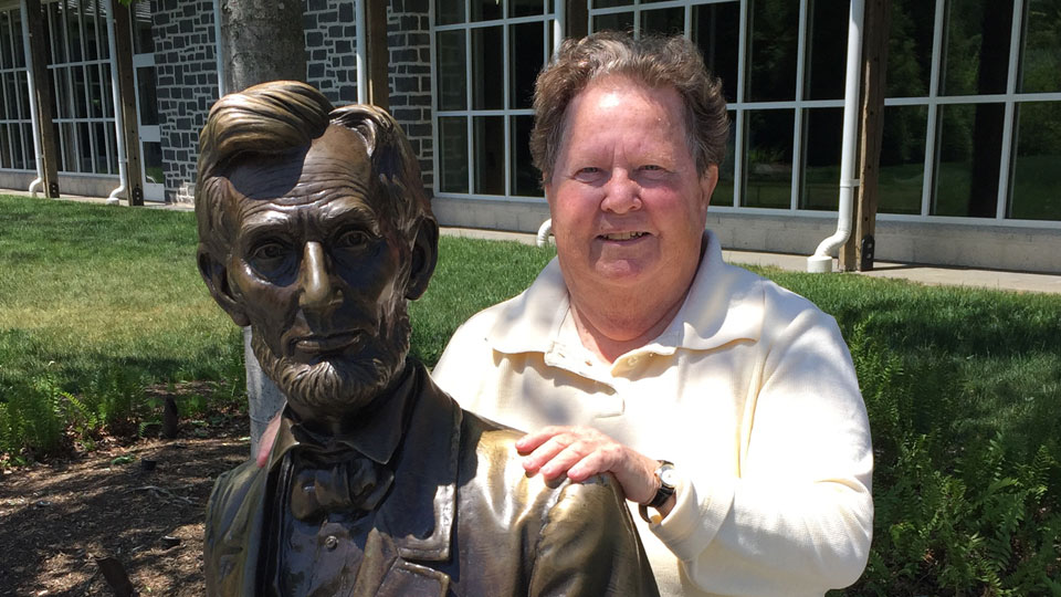 Carol Reardon with bronze statue of Abraham Lincoln