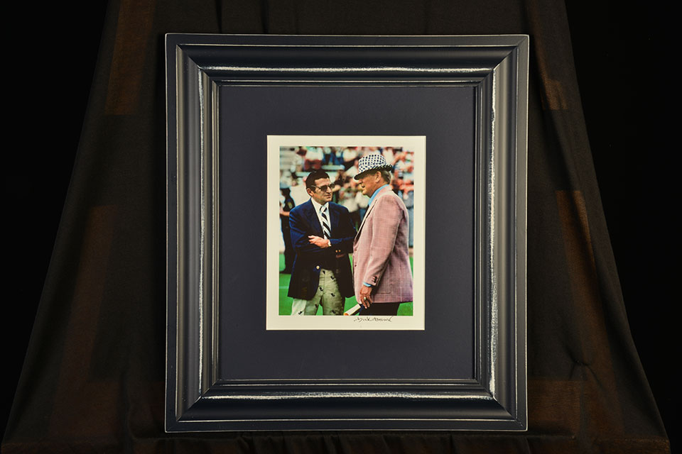 Framed photo of Joe Paterno and Bear Bryant, by Dick Brown.