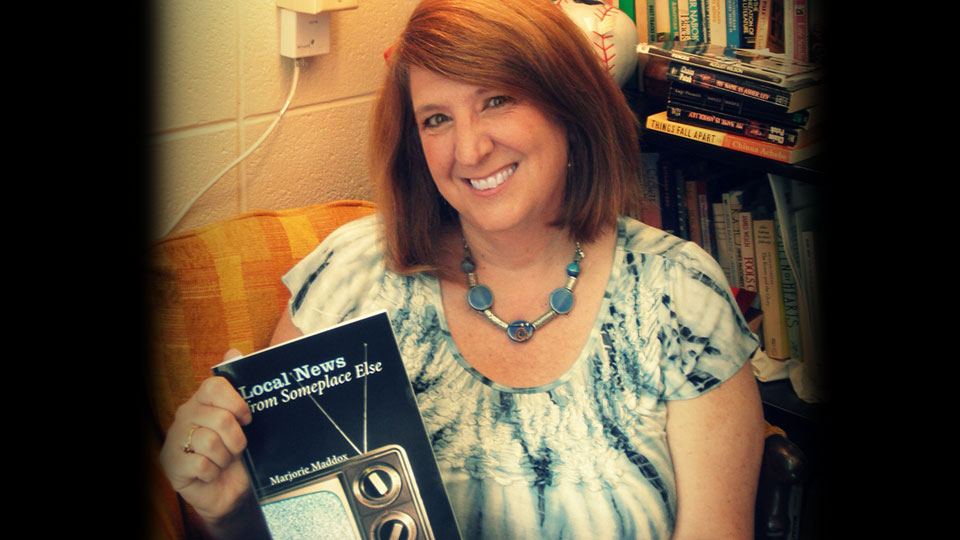Reviewer Marjorie Maddox with her book of poetry.