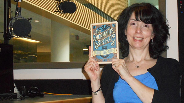 Local author Carrie Anne Noble shows off her debut novel.