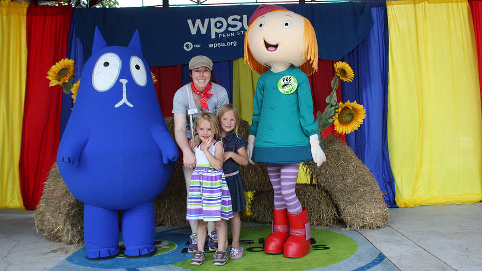 Guests posing for a photo with Peg + Cat at DelGrosso's Park