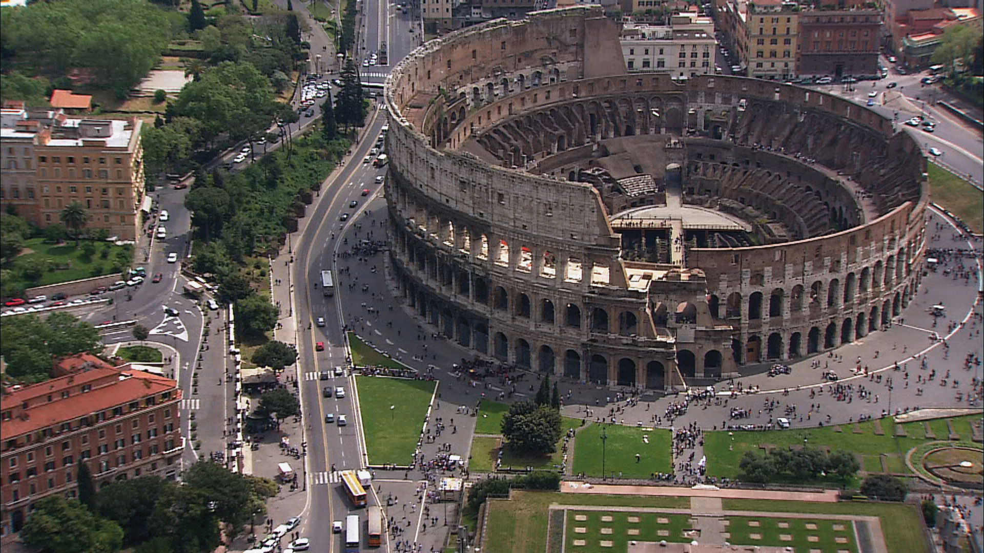 The Colosseum and surrounding city provide a striking juxtaposition of ancient and modern Rome.