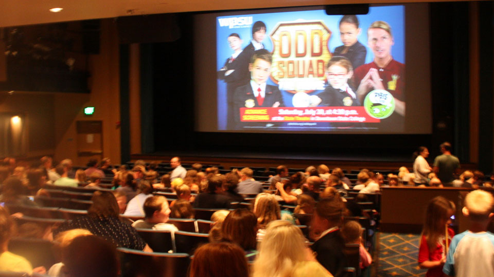 Theater audience getting ready to watch the Odd Squad Movie