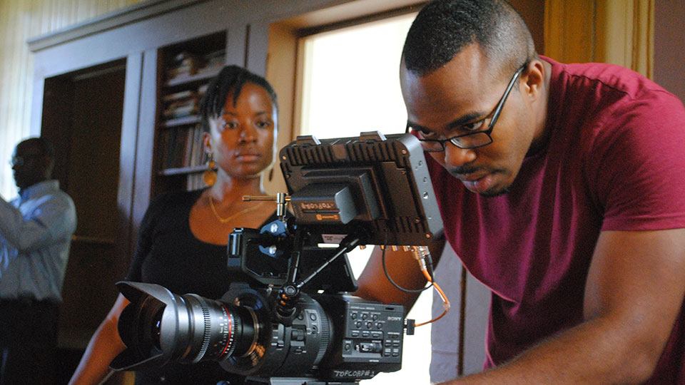 WPSU producer and videographer working behind video camera
