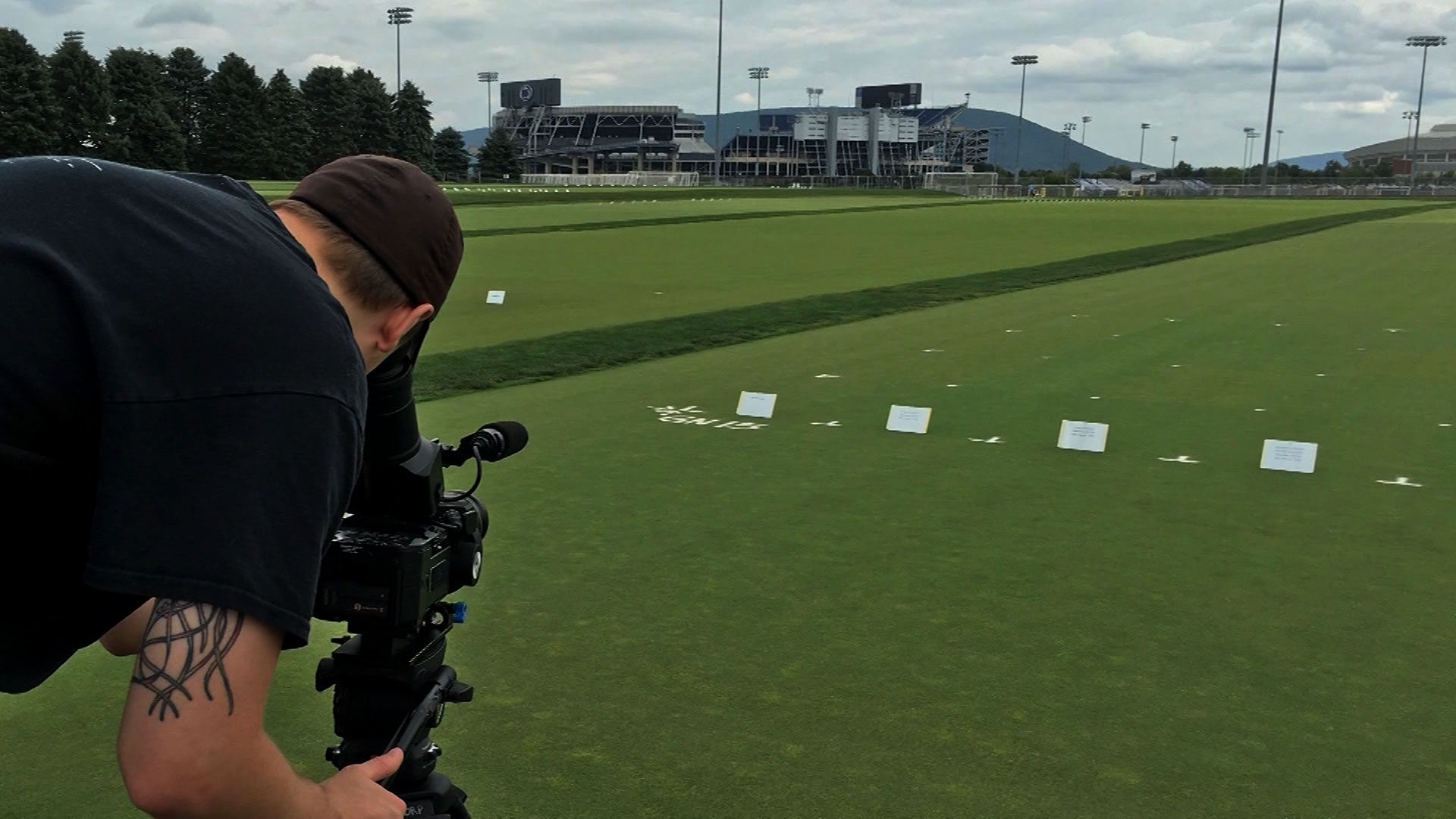 Videographer shoots video of turf grass