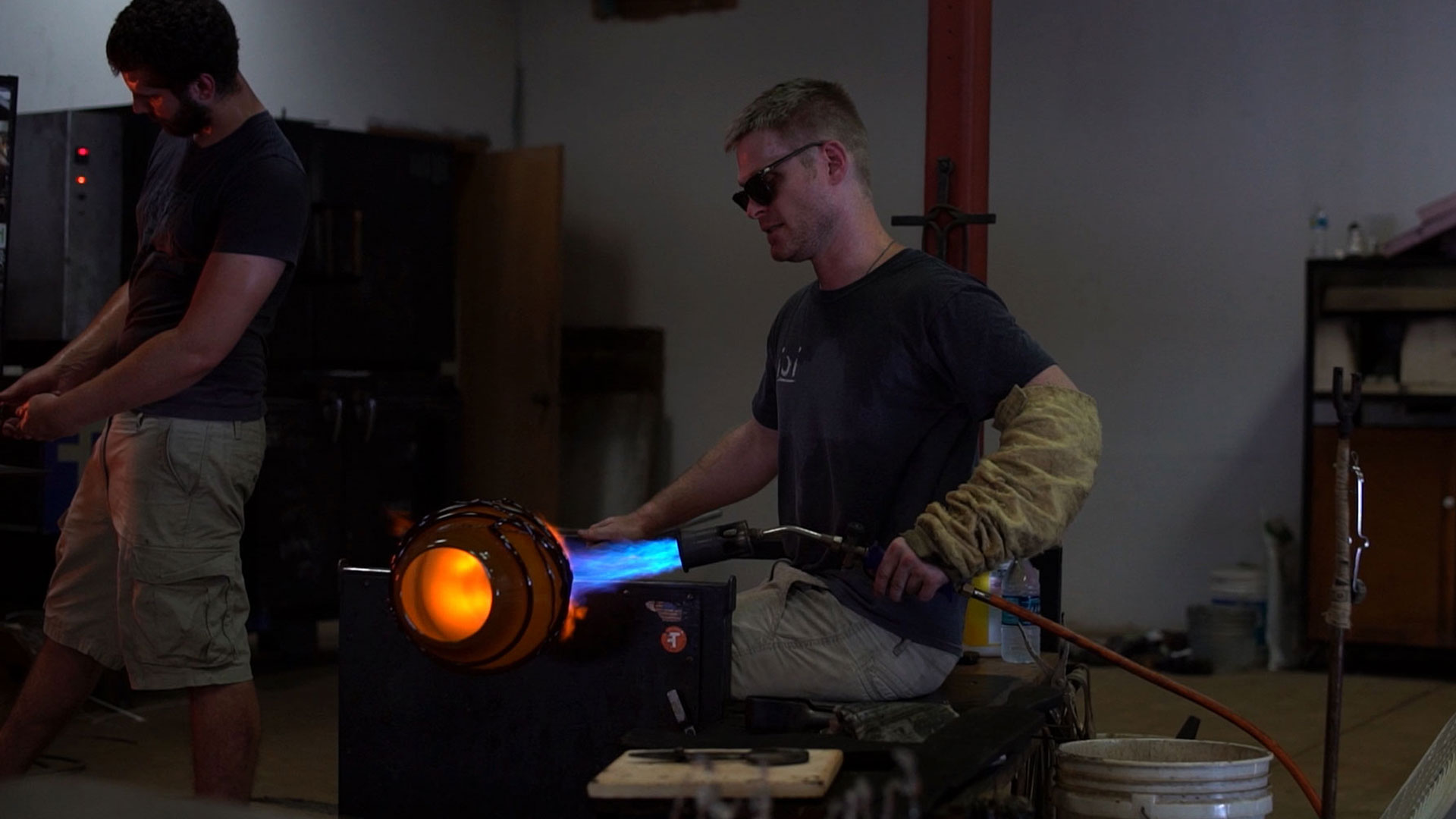 Ben Ahlgrim working with hot glass