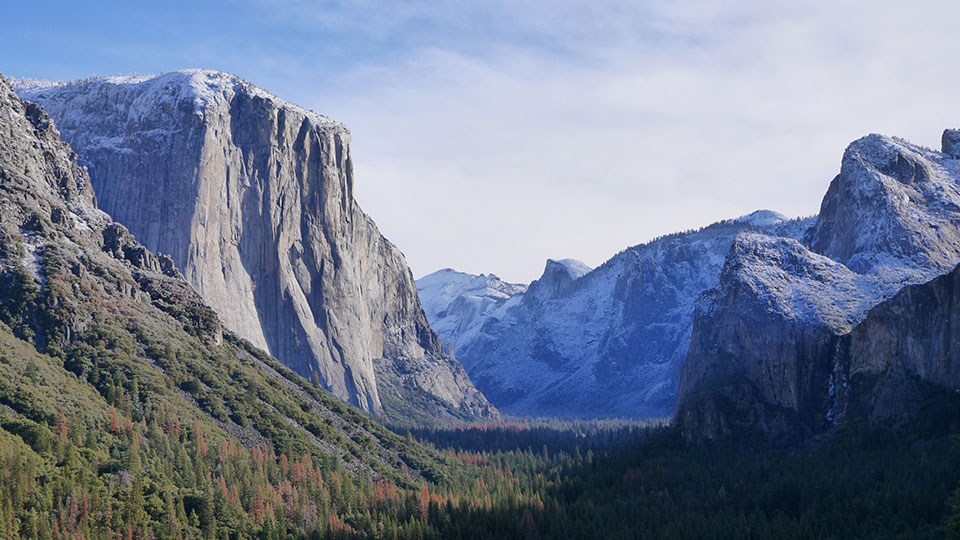 El Capitan and the surrounding mountains in Yosemite Valley, and 2,000-foot glaciers polished the granite into their iconic shapes. Yosemite National Park, California.