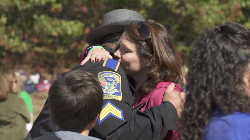 Nicole Hockley, mother of Sandy Hook victim, and first responder Sgt. William Cario.