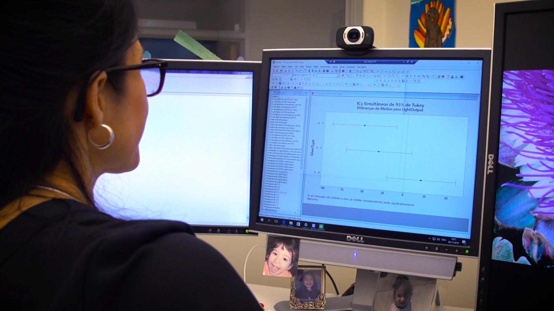 woman looking at technical software on computer screen