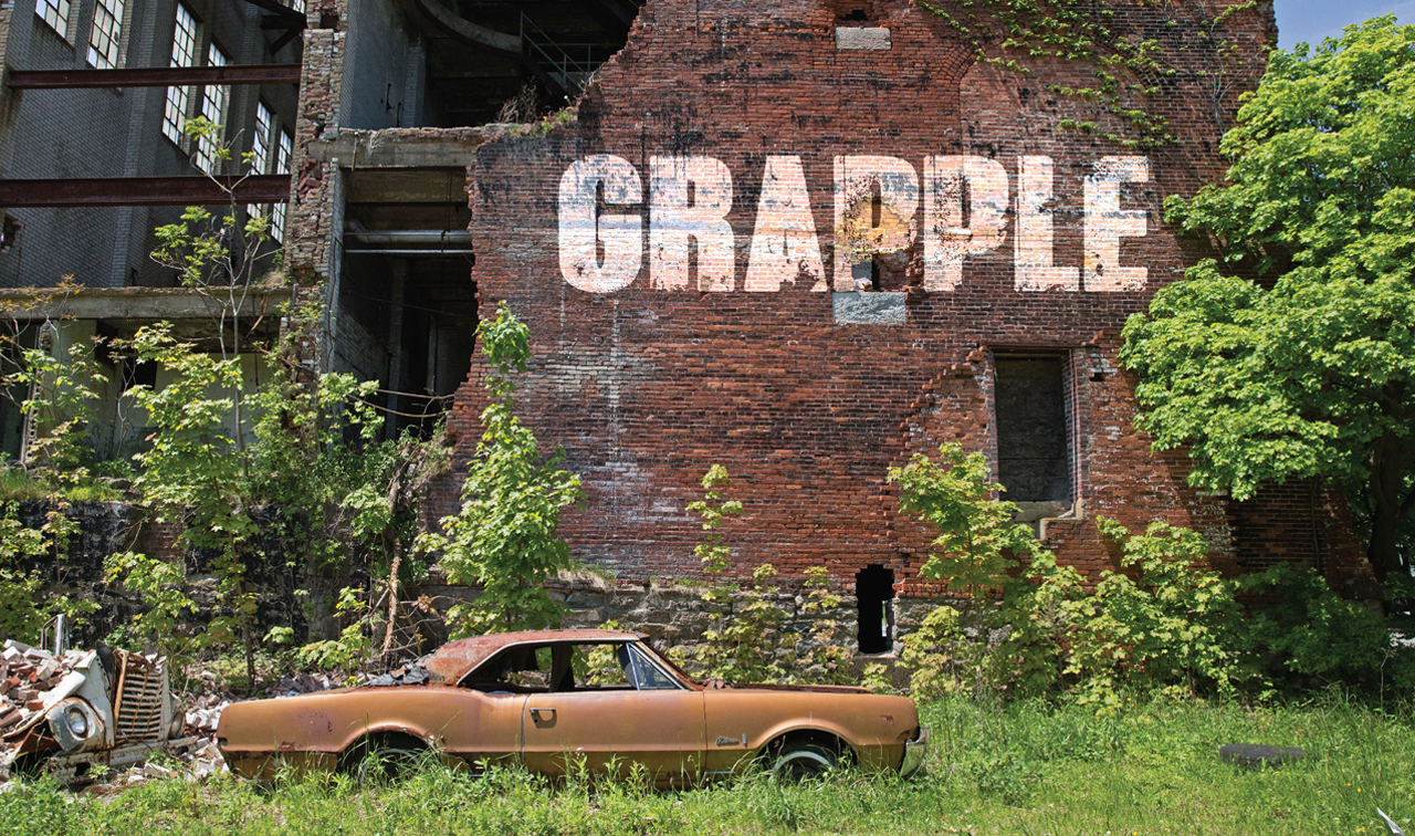 grapple logo on the side of an old building