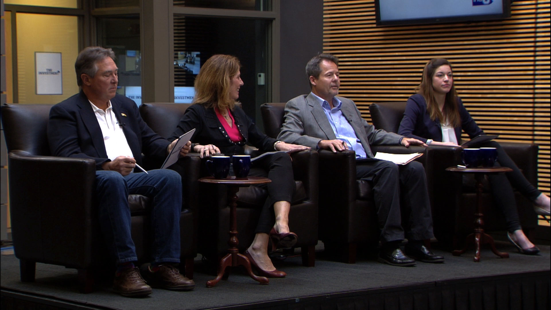 Panel of judges on the set of The Investment