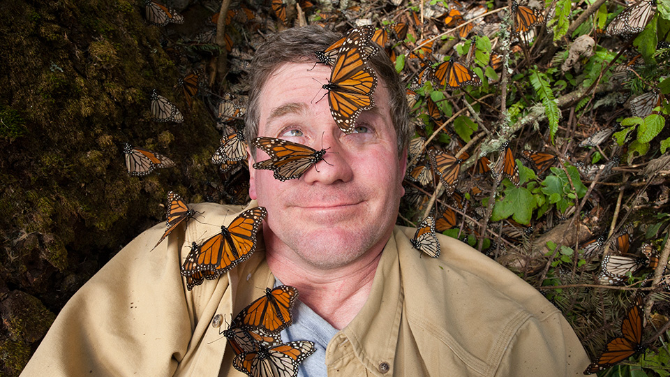 Joel Sartore takes a selfie with Monarch butterflies