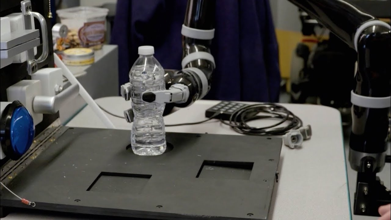 Robotic arm holding bottle of water