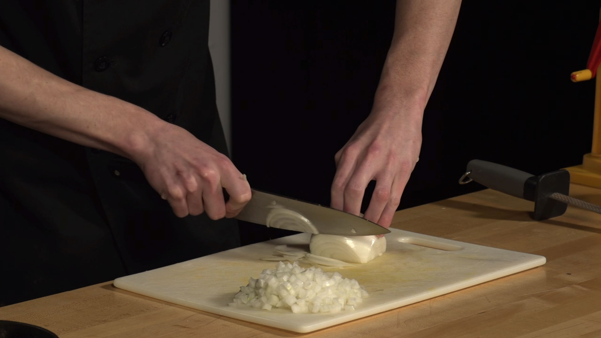 knife cutting through an onion