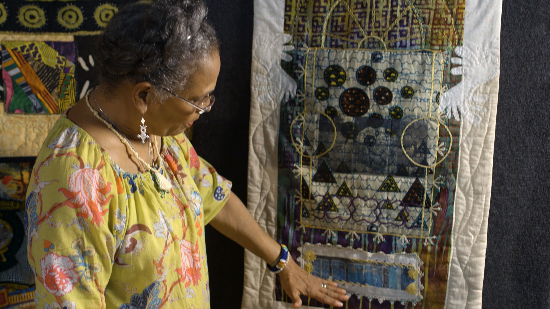 Tina Williams Brewer and her quilt Say It With Iron