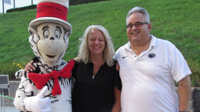 Cat in the Hat posing with guests at the Altoona Curve