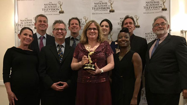 WPSU staff members posing for photo with Mid-Atlantic Emmy Award for Station Excellence