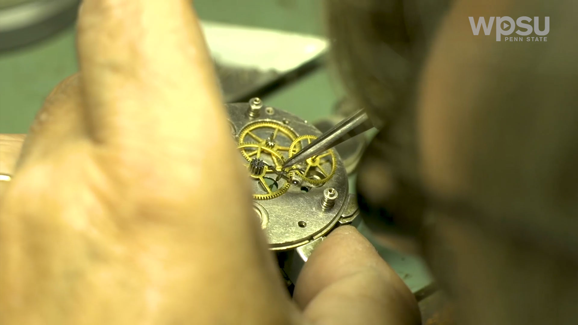 close up of gears of pocket watch