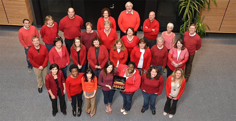 WPSU Staff members dressed in red sweaters to support Fred Rogers Day