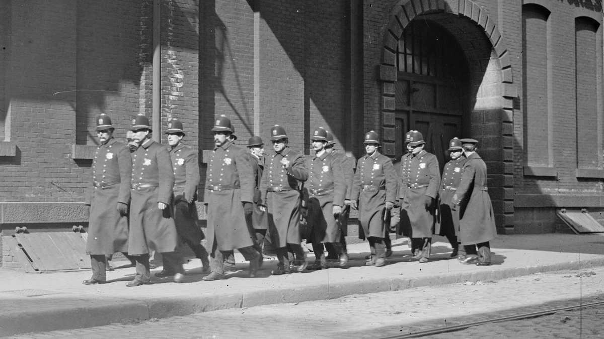 In the photograph, police patrol marching outside Baldwin Locomotive Works in Philadelphia, Pa. circa 1910.