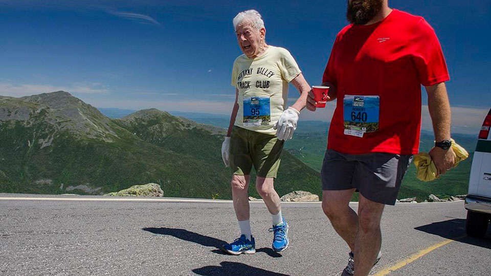 George Etzweiler, left, runs up Mount Washington. Credit Dan Houde / Mount Washington Road