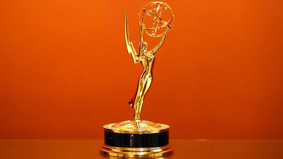 Emmy Award against orange background