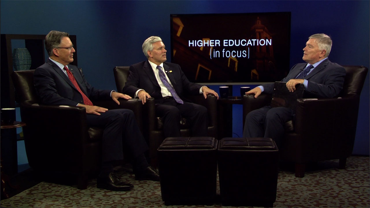 Jonathan Alger and Timothy Sands with Eric Barron on the set of Higher Education in Focus