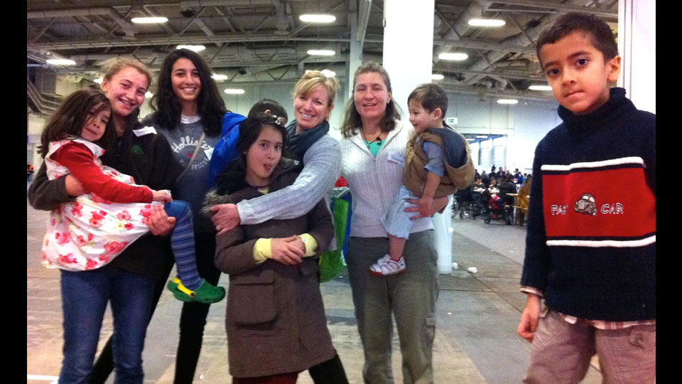 Penny Eifrig (third from right) with refugee kids and other volunteers, including her daughter Saede (second from left).
