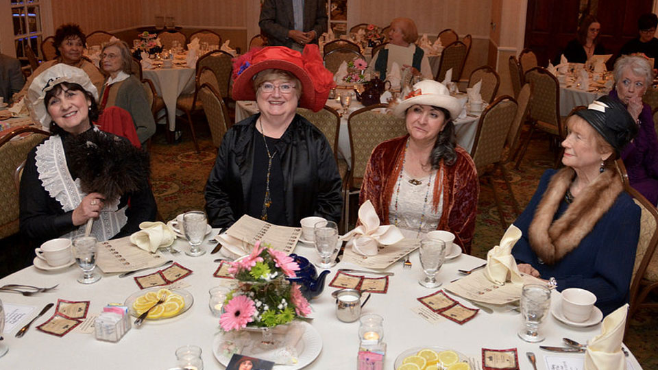 Guests sitting at a table at the WPSU Downton Abbey Farewell Event