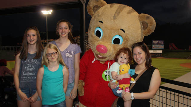 Fans pose for a picture with Daniel Tiger