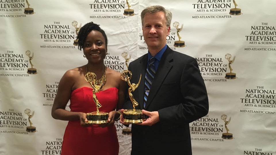 PSU Penn State producers Mindy McMahon and Kristian Berg holding their 2015 NATAS Mid-Atlantic Emmy awards