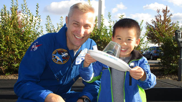 Astronaut James Pawelczyk with a young guest at the WPSU Cosmic Carnival