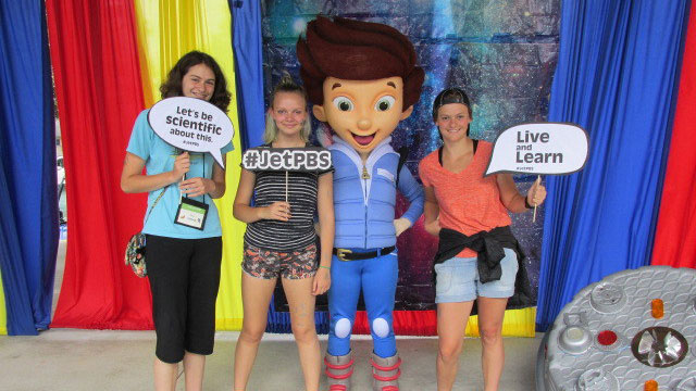Guests pose for a picture with PBS Kids character Jet Propulsion