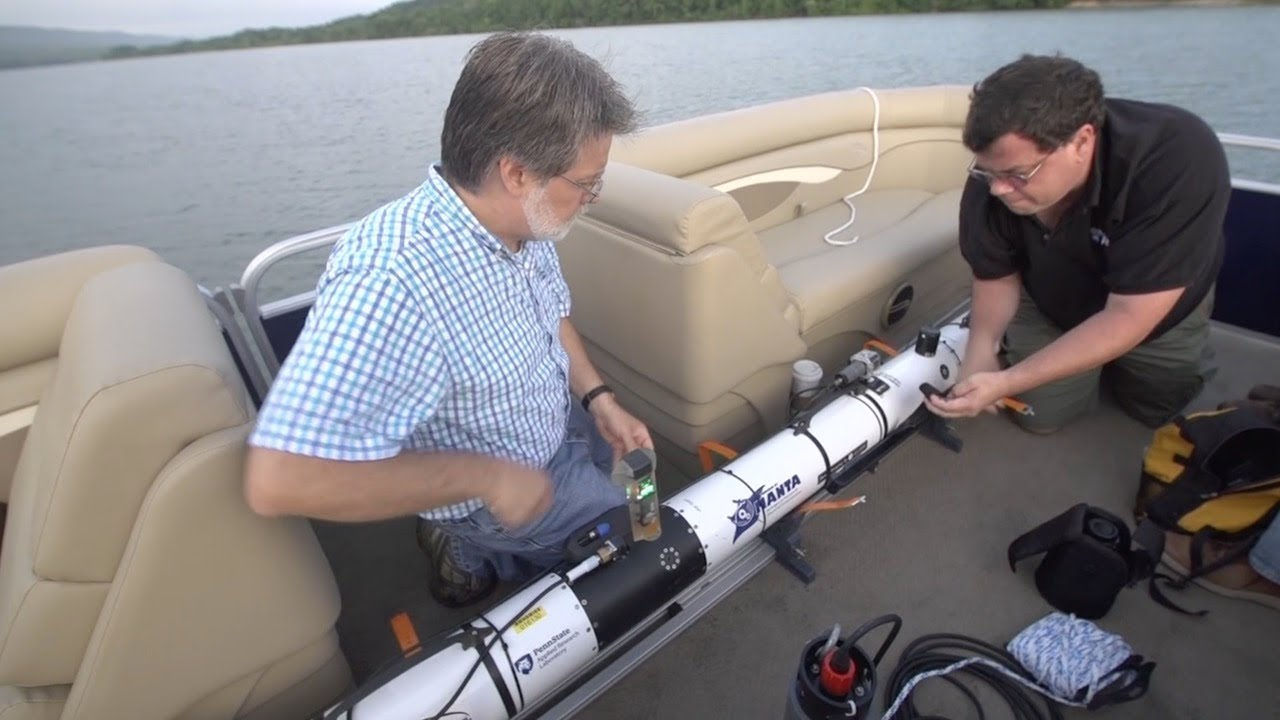 Scientist with self-driving submarine