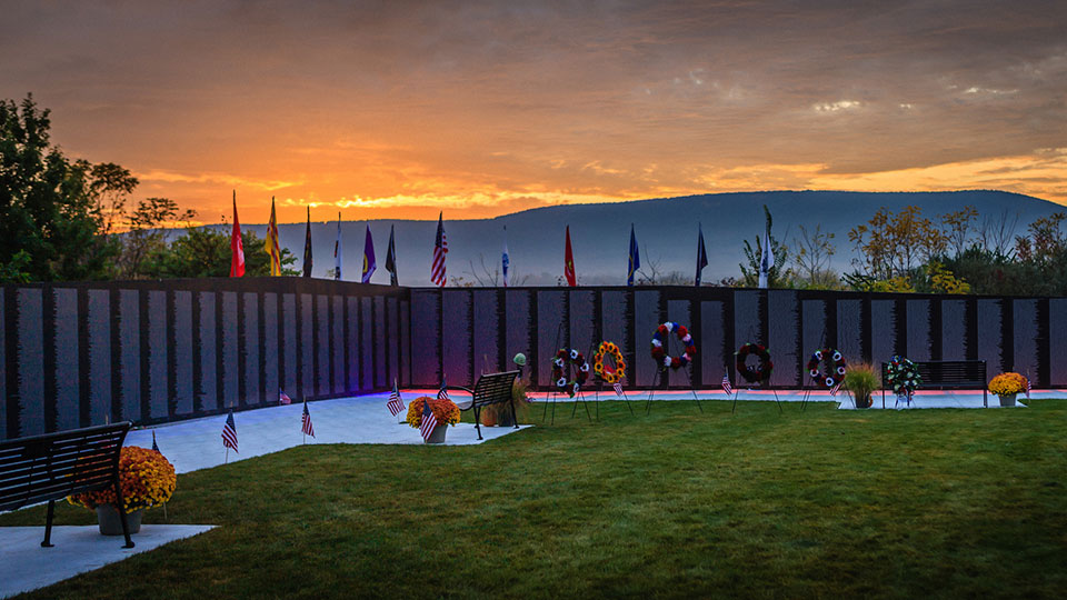 Traveling Vietnam Wall with Mount Nittany in the background at sunset