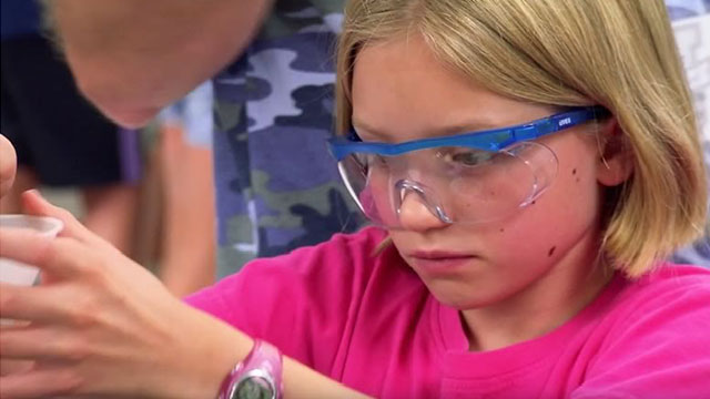 young girl wearing safety glasses