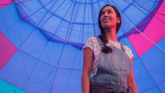 woman standing under hot air balloon