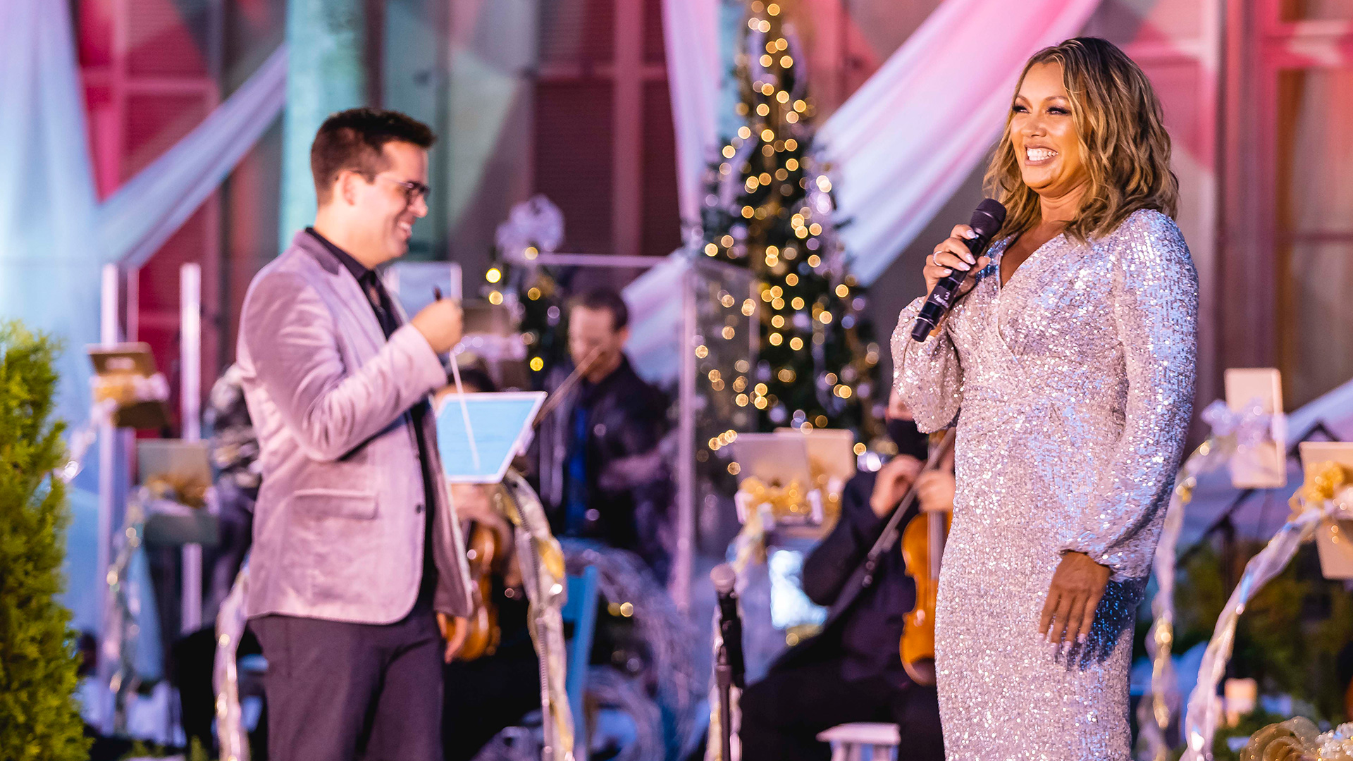 Maestro Luke S. Frazier and host Vanessa Williams