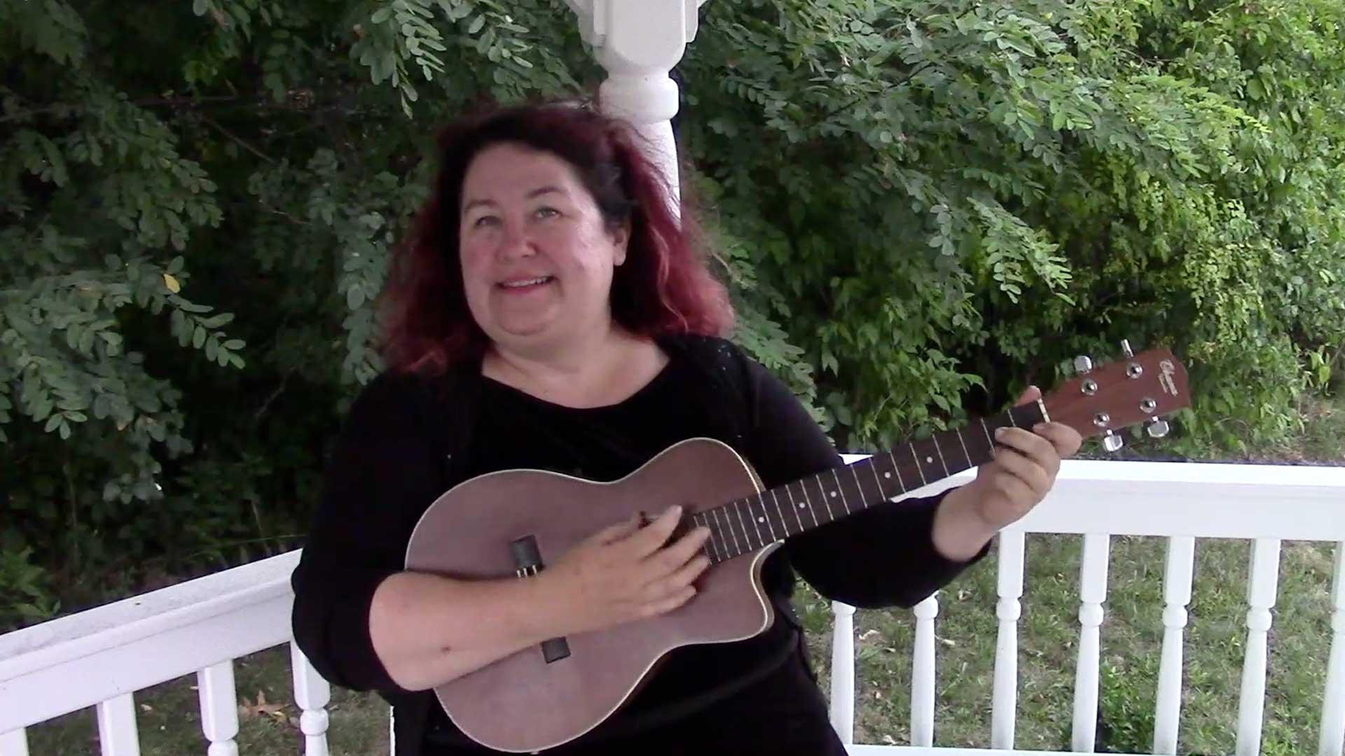 Melanie plays her ukulele